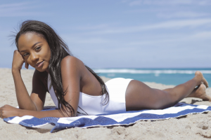 Black woman sunbathing on the beach
