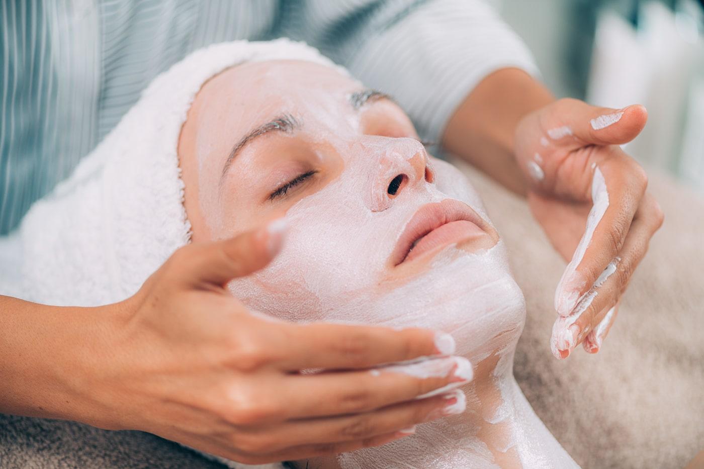 Woman receiving facial